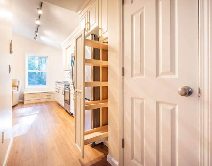 A pull out cabinet next to the fridge for more storage space