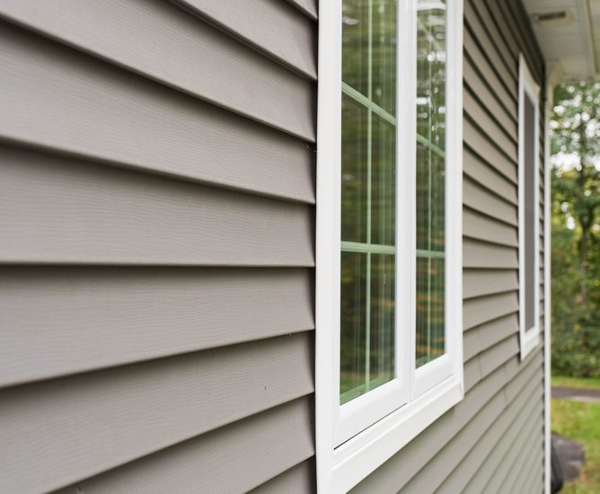 A home with new grey vinyl siding